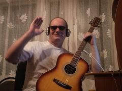Алексей Семиврагов. - Молодой гитарист.